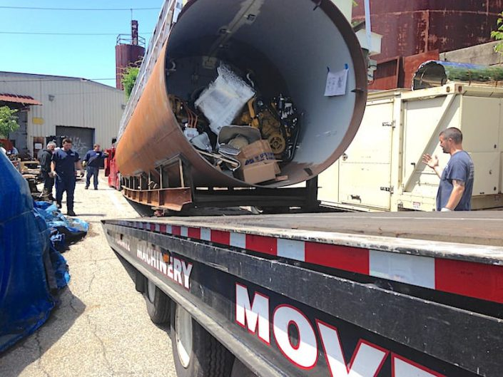hull assembly leaves Bridgeport shop being loaded on truck
