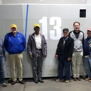 USSVI members from Westport visiting Connecticut submarine build pose in front of the sail.