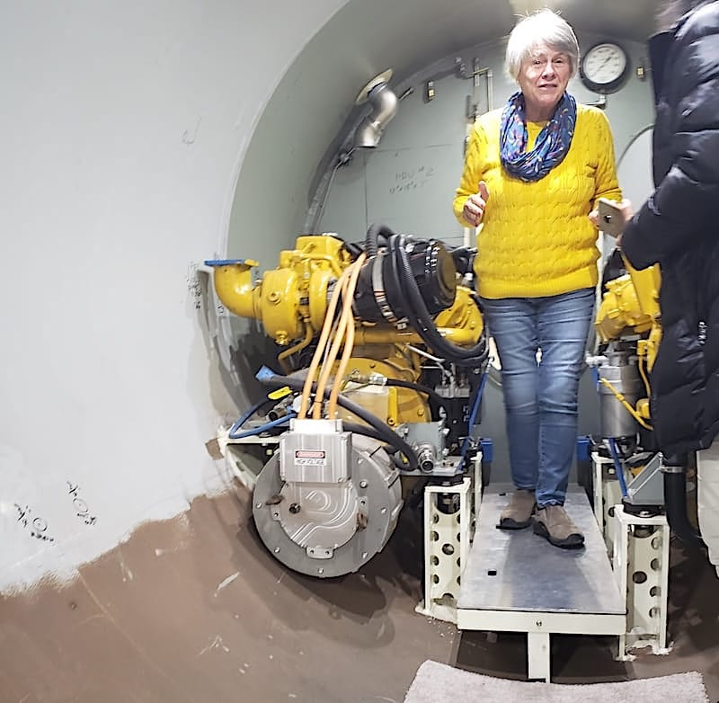 USSVI Westport member Diane Megarle in the engine room of private submarine being built in Connecticut.